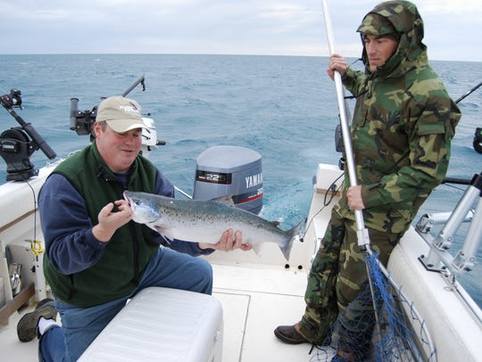 Jim Frazer, left, holds an 8.55-pound Atlantic salmon