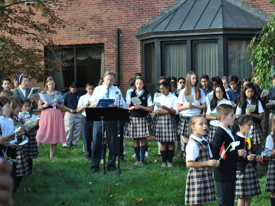 Students at St. Augustine of Canterbury School aim
