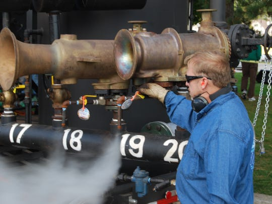 Bruce Rooen lets off some steam from a large boiler at Whistles on the Water on Saturday at Palmer Park in St. Clair.