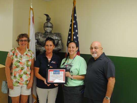 Sharon Tufarelli and Marcie Chatters with Sun Communities Ocean Breeze Resort in Jensen Beach present a certificate of thanks and appreciation to Renaissance Charter of St Lucie Principal, Christiana Coburn and After Care Director, John Tufarelli. The students at Renaissance Charter of St Lucie wrote thank you letters and cards to military men and women serving overseas.