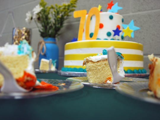 Cake is served at San Angelo YMCA's 70th anniversary