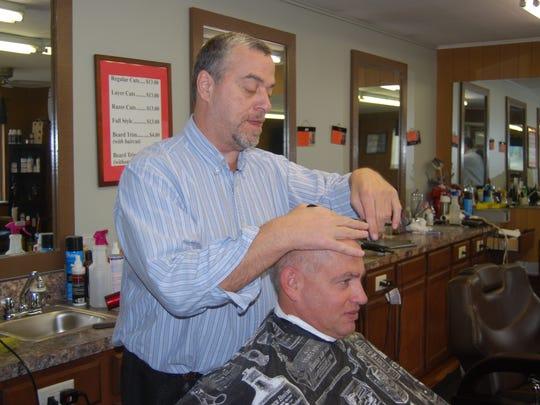 Greg Lanzillotta, owner of the Del Fair Barber Shop,