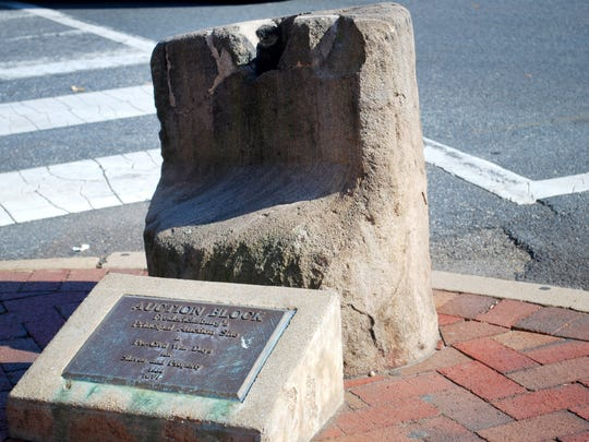 The slave auction block and plaque at the corner of Charles and William streets in Fredericksburg.