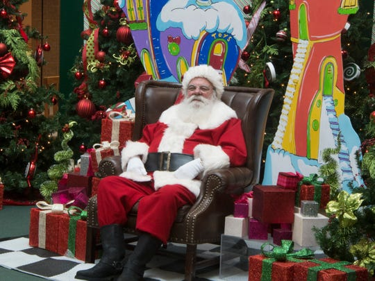 Santa Claus awaits his next visitor at the Oakdale Mall in Johnson City on Wednesday, Dec. 13, 2017.