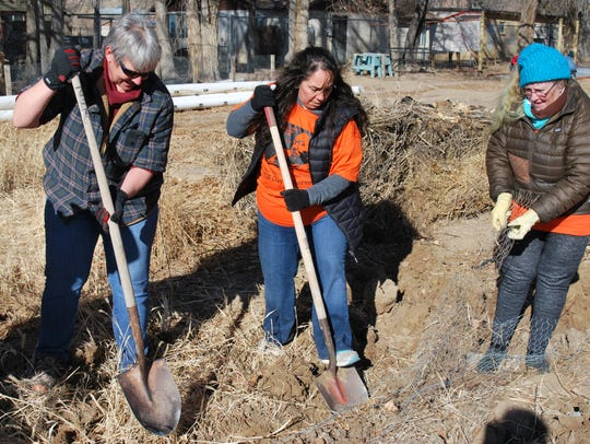 Volunteers Beverly Todd, left, Donna Fernandez and