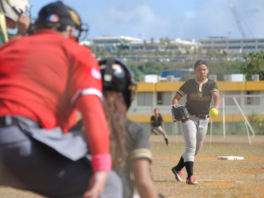 Scenes from the IIAAG High School Girls Softball league opening game held Saturday Jan. 20 at the John F. Kennedy Islaneders field. The defensing champion Islanders won 16-1 i in a game shortened by mercy rule.