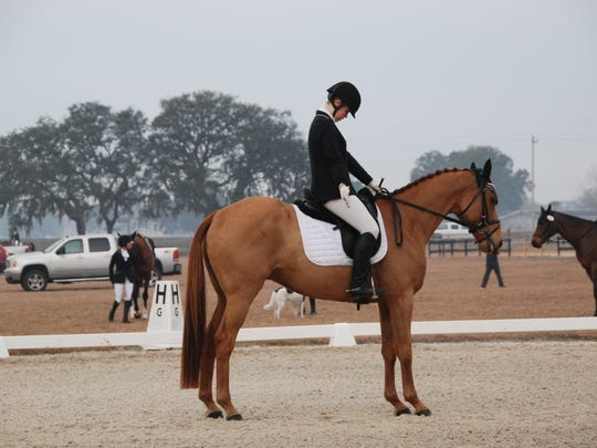 Anna Martin salutes the judge to complete her dressage test at the Winter I Horse Trials in Altoona.