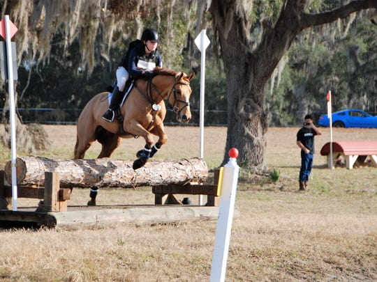 Anna Martin, riding Professor Pegasus, takes the first jump into the water combination in cross-country during the Winter 1 Horse Trials.