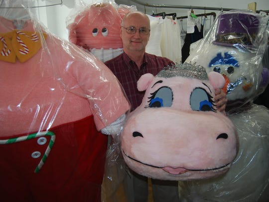 Ray Kroner, owner of Kroner Dry Cleaners, stands amidst costumes from a recent Cincinnati Pops Orchestra holiday program. Kroner Dry Cleaners cleans the costumes and wardrobes for a number of local arts organizations. Feb. 6, 2018