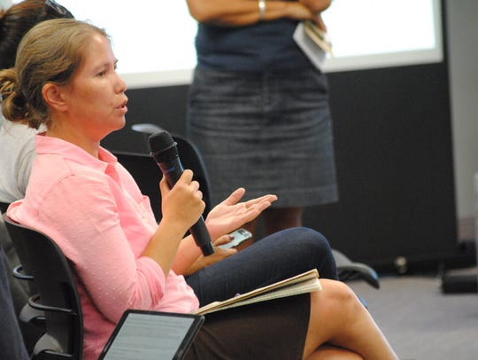 Adrienne Loerzel, the Guam Coral Management Liaison and Coastal Specialist for the  National Oceanic and Atmospheric Administration, offers a suggestion at a forum for responsible off-roading held Feb. 15 at the University of Guam.