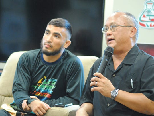 Joey Crisostomo Jr., left, and his father, Joey Crisostomo, speak at a forum on responsible off-roading held Feb. 15 at the University of Guam.