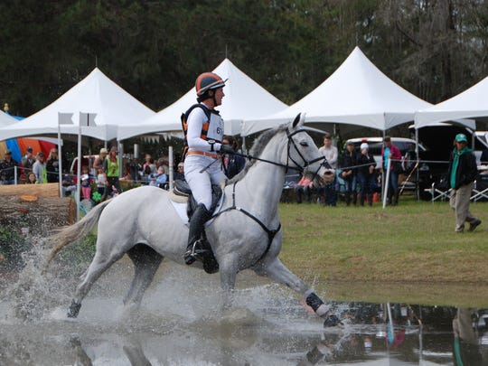 Olympian Lauren Kieffer, riding Landmark's Monte Carlo, navigates the first water combination Saturday at Red Hills Horse Trials.