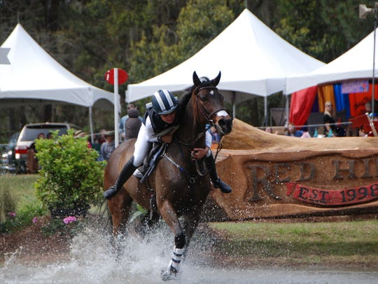 Shelby Brost struggles to recover after a tricky jump leading into the first water combination Saturday at the Red Hills Horse Trials.