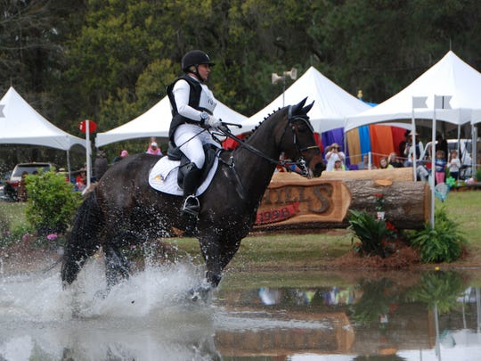 Marilyn Little on RF Scandalous canter through the first water combination during their cross-country round Saturday at the Red Hills Horse Trials.