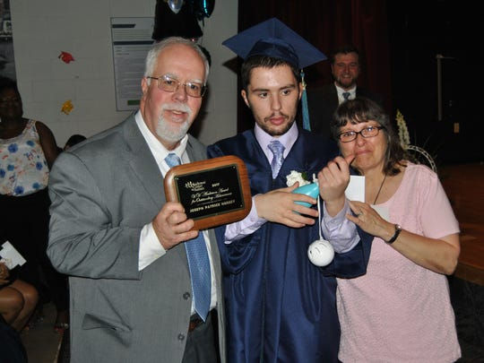 Ed and Concetta Hussey with their son Joey at the Anderson Center For Autism's graduation on June 23, 2017.