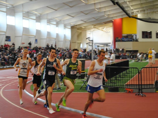 George Kelly (in green) races indoors for Adams State.