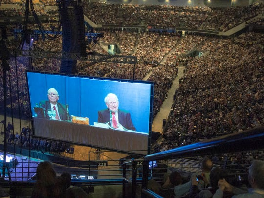 Berkshire Hathaway Chairman and CEO Warren Buffett, right, and his Vice Chairman Charlie Munger are seen on a giant screen during the Berkshire Hathaway shareholders meeting in Omaha on May 3, 2013.