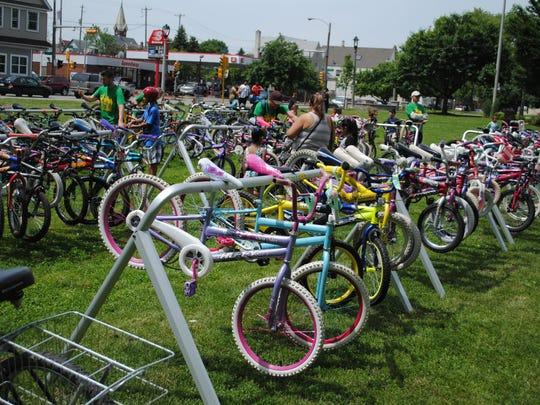 The community donates hundreds of bikes to the annual