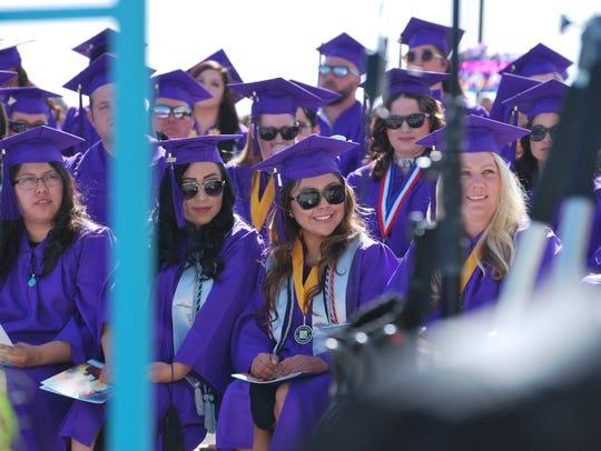 Graduates listen to student speaker Maria Oliva's address