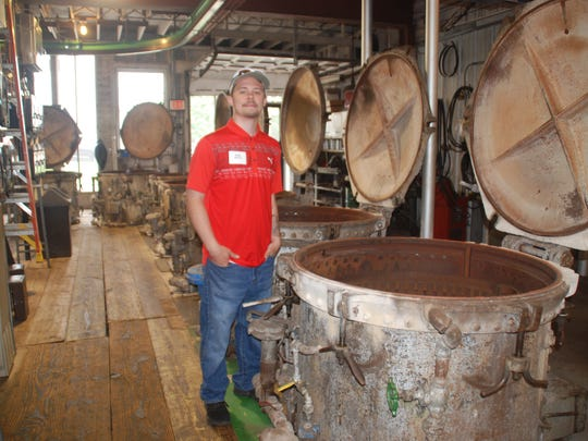 John Wells, in his sixth year of working at Lodi Canning Company, was on hand to show visitors the cooking room, where baskets of cans are loaded into pressure cookers for steam processing. The large cooking room sees use during the pea pack and making of cream style corn at the cannery.