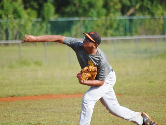 A Guam Senior Little League All-Star pitcher throws heat in a June 22 practice at the Dededo Sports Complex.