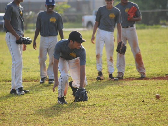 Guam Senior Little League All-Stars do some fielding practice June 22 at the Dededo Sports Complex.