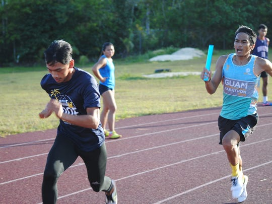 Paul Dimalanta nad Joseph Aguon get ready for a relay handoff at the Okkodo High School track on June 29, 2018. The two are part of Guam's 4X100 relay team at the Micronesian Games in Yap this July.