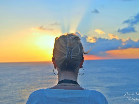 "Jacob Wenzel: ""Taken on a cruise in the Caribbean, April 2018. The subject is my mother, and I chose this picture for the following reasons. Because the subject is looking away, I feel this could be any woman. The viewer is able to decide if it is the end of the day, or the beginning of a new one. And in turn, the viewer can decide if the subject is traveling toward something, or leaving something behind. Finally, I feel this picture positively represents the beauty I see in my mother."" Jacob Wenzel, 15, lives in Henrietta. ""I have only become interested in photography in the past couple of years. In this short time, I have come to love all parts of this hobby."""