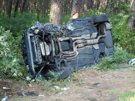 Three people were hospitalized after a head-on collision