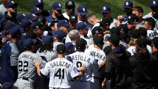 Players from the Colorado Rockies and San Diego Padres scuffle after Colorado's Nolan Arenado was hit by a pitch from Padres starting pitcher Luis Perdomo in the third inning.