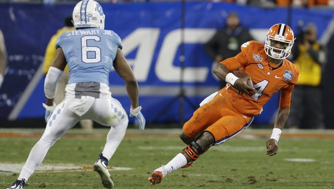 *FILE - In this Saturday, Dec. 5, 2015 file photo, Clemson quarterback Deshaun Watson (4) runs the ball as North Carolina's M.J. Stewart (6) moves in for the tackle during the first half of the Atlantic Coast Conference championship NCAA college football game in Charlotte, N.C. NCAA President Mark Emmert says whether the Atlantic Coast Conference decides to follow the association's lead and pull events out of North Carolina because of a state law that some say can lead to discrimination against LGBT people is up to the league and its members. The ACC championship football game is schedule to be held in Charlotte on Dec. 3. (AP Photo/Bob Leverone, File)