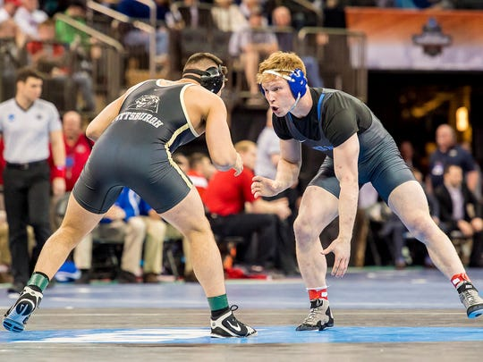 Former South Kitsap wrestler Conner Hartmann (right) was a three-time All-American at Duke University. He is now an assistant coach with the Wolves.