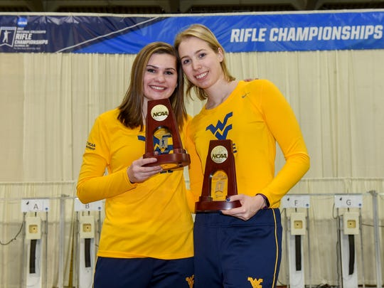 Morgan Phillips, left, poses with teammate Milica Babic after winning a NCAA title.  Phillips won a title for smallbore and Babic won for air rifle.