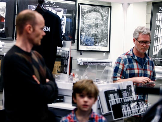 Visitors to the National Civil Rights Museum look over merchandise in the gift shop Wednesday afternoon.
