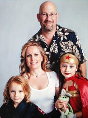 A family portrait shows Dr. Teresa Sievers with husband Mark Sievers and children Josephine and Carmela. (Submitted photo)