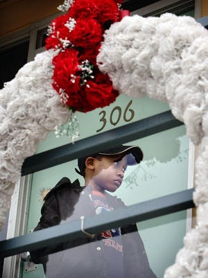 Zachary Westbrook, 7, of Atlanta pauses on the balcony outside Room 306 during a visit to the National Civil Rights Museum where Martin Luther King Jr. was struck by an assassin's bullet on April 4, 1968.
