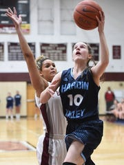 Hardin Valley's Lizzie Davis (10) shoots a layup against Bearden's Chanler Geer (23) during a high school basketball game at Bearden High School in Knoxville on Monday, Feb. 29, 2016.