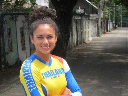 In this photo taken on Thursday, June 23, 2016, BMX rider Amanda Carr poses for a photograph during a visit to Bangkok, Thailand. Four years ago, Amanda Carr was coming to terms with the disappointment of not qualifying for the United States BMX team traveling to the Olympics in London. Now she is finalizing her packing plans for Rio de Janeiro and harboring genuine medal ambitions. (AP Photo/Chris Lines)