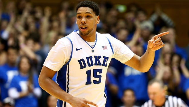 Jahlil Okafor of the Duke Blue Devils reacts after a basket against the Elon Phoenix during their game at Cameron Indoor Stadium on December 15, 2014 in Durham, North Carolina.