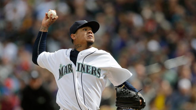 Seattle Mariners starting pitcher Felix Hernandez throws against the Los Angeles Angels in the third inning of an opening day baseball game, Monday, April 6, 2015, in Seattle.