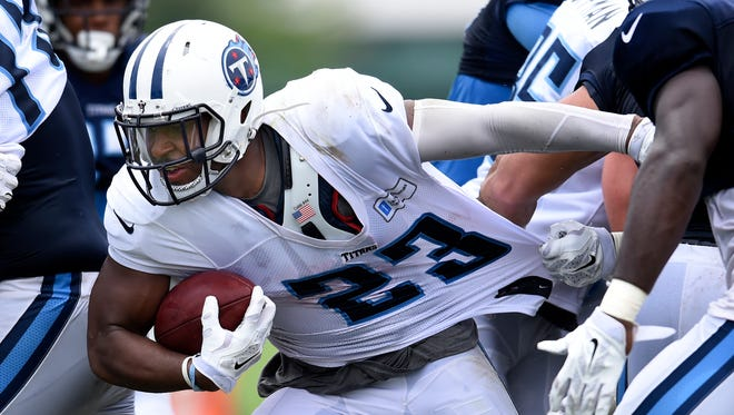 Titans running back David Cobb (23) tries to get through the defense during practice at St. Thomas Sports Park Sunday Aug. 16, 2015, in Nashville, Tenn.