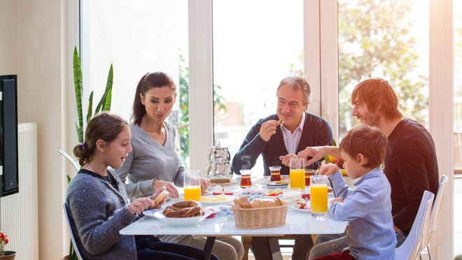 Family dinner slows down eating and lets family reconnect.