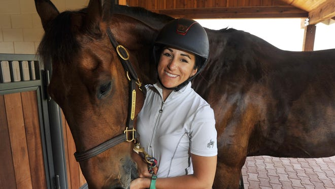 Visalia-native Lauren Billys and her Irish sport horse Castle Larchfield Purdy after training in Carmel Valley on Tuesday, April 19, 2016.