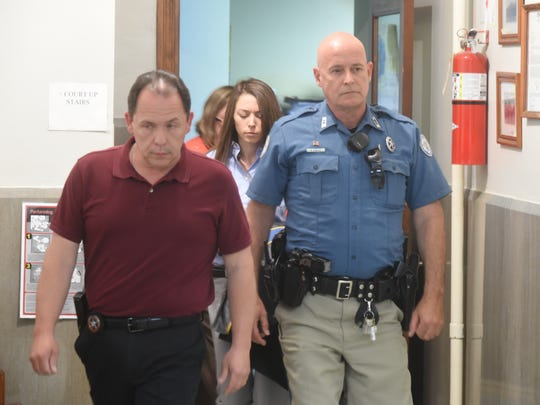 Christina Scroggin is led from the courtroom by officers with the Marion County Sheriff's Office.