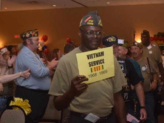 ANI VFW Convention ANI VFW Convention Vietnam veterans parade into the meeting room to applause and cheers at the Best Western Convention Center for the Veterans of Foreign Wars and Ladies Auxiliary's 84th annual State Convention Friday, June 26, 2015.-Mel
