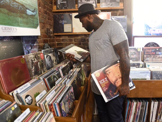 Delanie Walker's love for vinyl records matches that of his mother, Vicy  Walker, who collected vinyl and mastered lowering the needle onto the edge of the album.