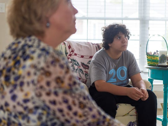 Millsboro Middle 8th-grader Aaron Doll and his mother