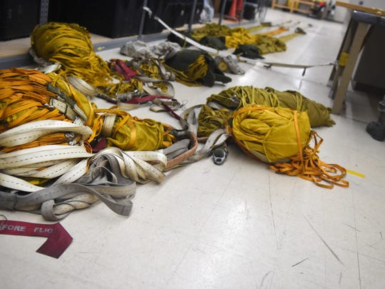 Several parachutes lie on the floor of the Aircrew Flight Equipment shop at Holloman Air Force Base July 21. AFE personnel manage the inspection, maintenance and adjustments to the equipment assigned to the pilots they support. (Last names are being withheld due to operational requirements).