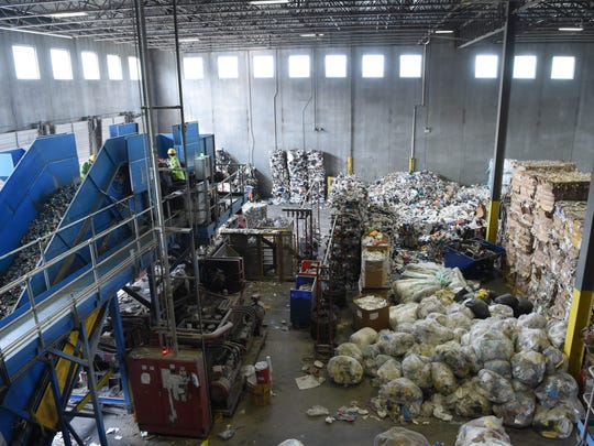 A view of some of the bails at ReCommunity Recycling in Beacon, as well as a pile of plastic bags.