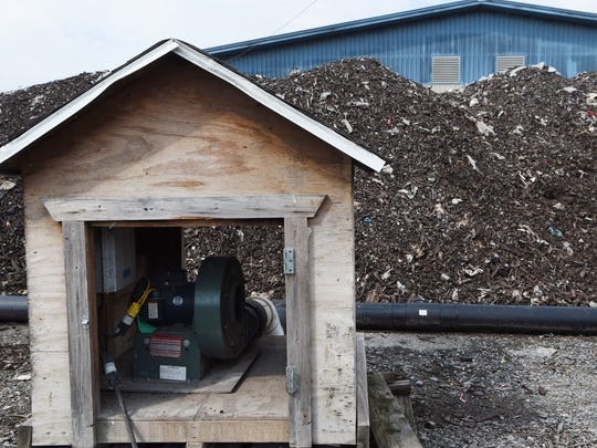 """This small structure, known as the """"doghouse,"""" holds a blower, which pumps air into the pile of food waste and wood chips through a series of pipes at the Ulster County Resource Recovery Agency in the Town of Ulster. This process helps turn the pile into compost."""